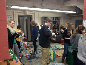 Hard at work stringing water bottles for our Bascom Hill display.